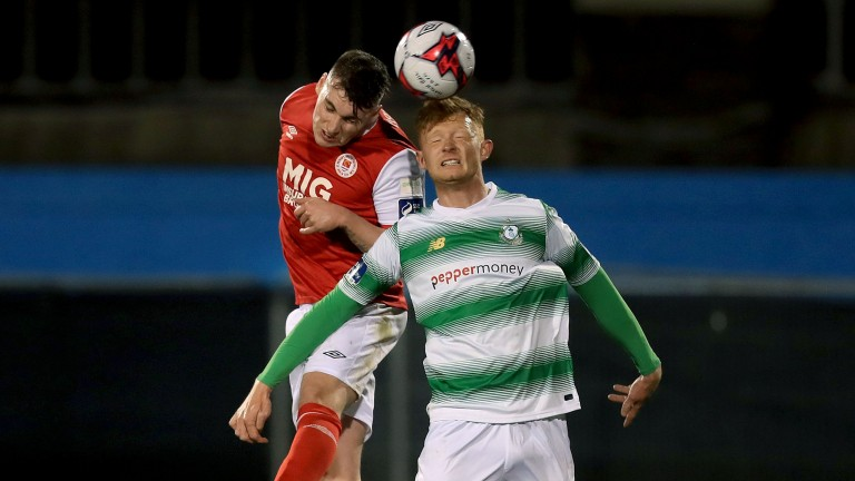 Kevin Toner (red shirt) is part of a powerful St Patrick's back four