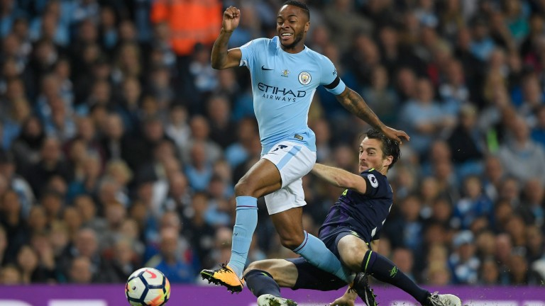 Raheem Sterling tries to evade the challenge of Leighton Baines in Manchester City's draw with Everton in August