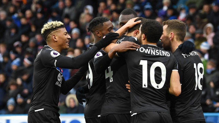 Crystal Palace players celebrate their 2-0 victory at Huddersfield