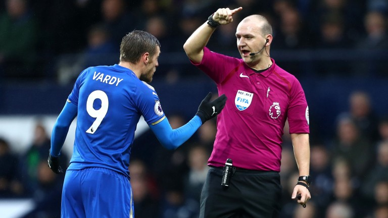 Bobby Madley has a word with Leicester's Jamie Vardy