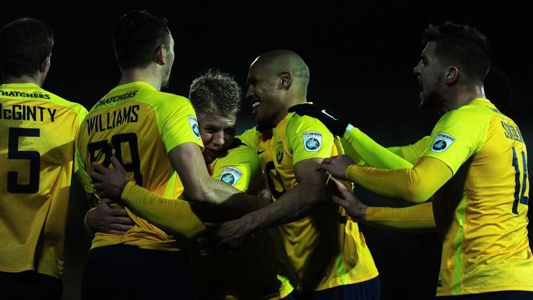 Torquay celebrate after Brett Williams scores against Sutton