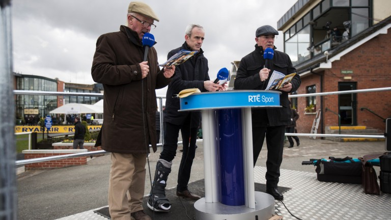 Mics up: Ruby Walsh, with right leg strapped up, is live on RTE alongside father Ted (right) and Robert Hall