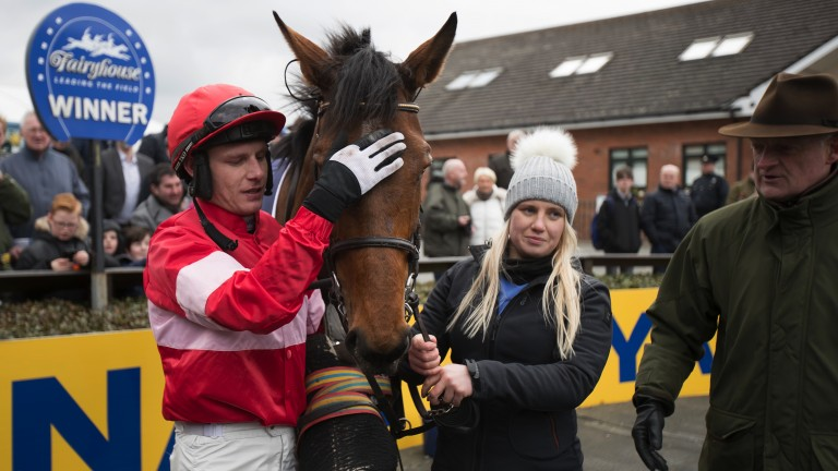 My girl: Paul Townend gives Laurina a pat as trainer Willie Mullins looks on following her win in the Grade 1 Mares Final