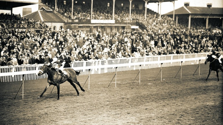 Red Rum is kicked for home by Geoff Lewis at Doncaster before just holding on