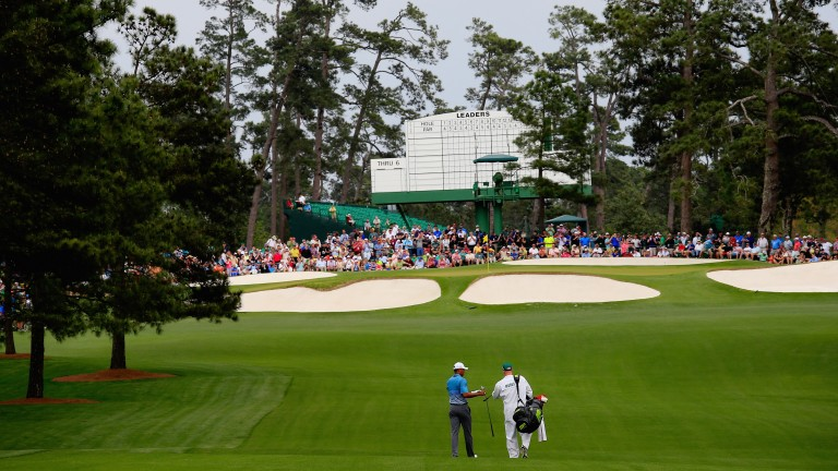 Tiger Woods strolls up the seventh fairway at Augusta National