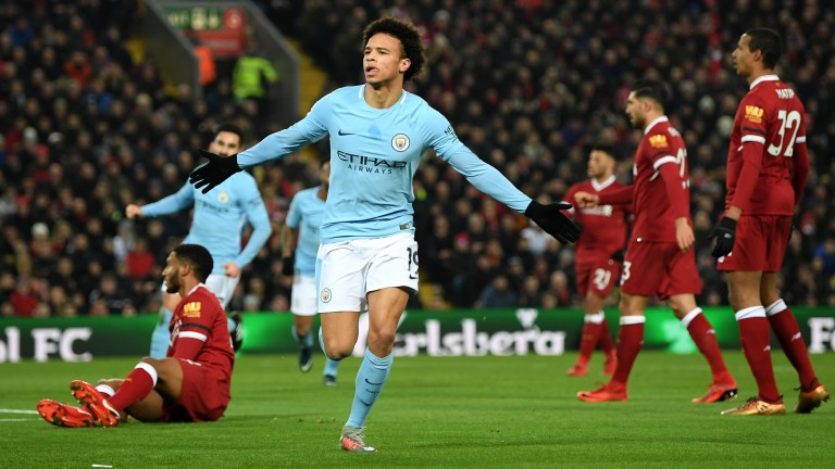 Leroy Sane of Manchester City celebrates after scoring against Liverpool