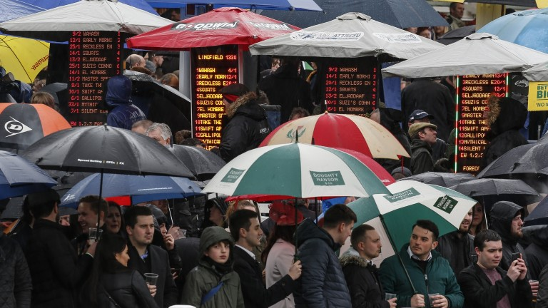 Umbrellas up: that's the trend as the wet spring continues to haunt racing