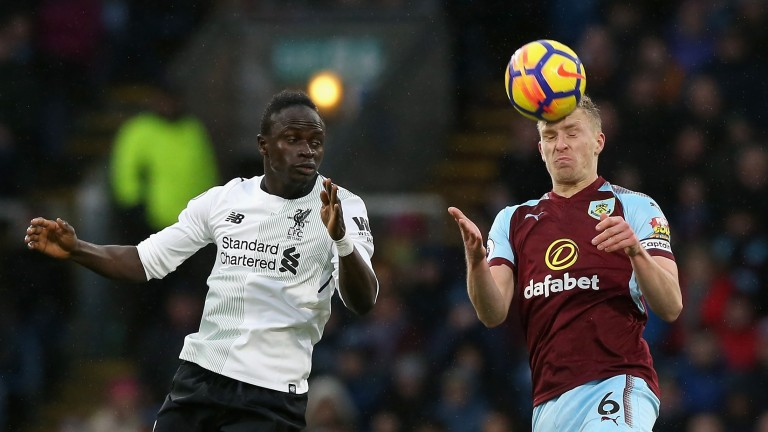 Defender Ben Mee (right) has been a rock for overachieving Burnley this season