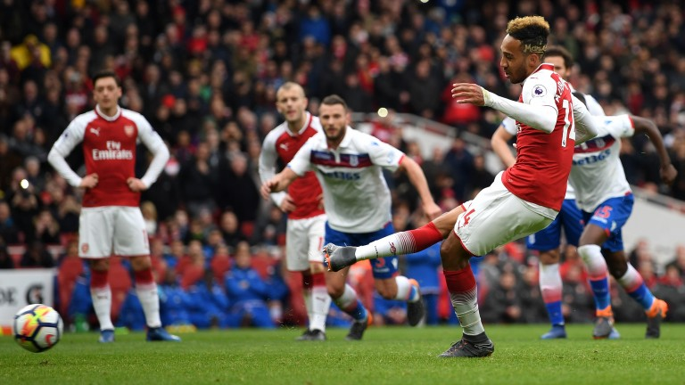 Pierre-Emerick Aubameyang converts a penalty in Arsenal's 3-0 win over Stoke
