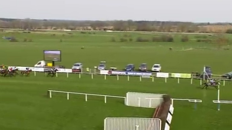 Maxime Tissier and Iconic Sky pass the post clear on the first circuit of the 2m4f handicap hurdle at Fakenham