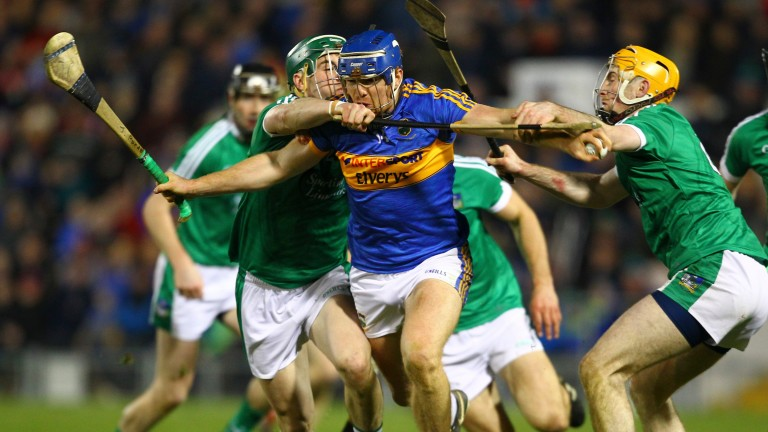 Tipperary's Jason Forde battles with Seán Finn and Richie English of Limerick