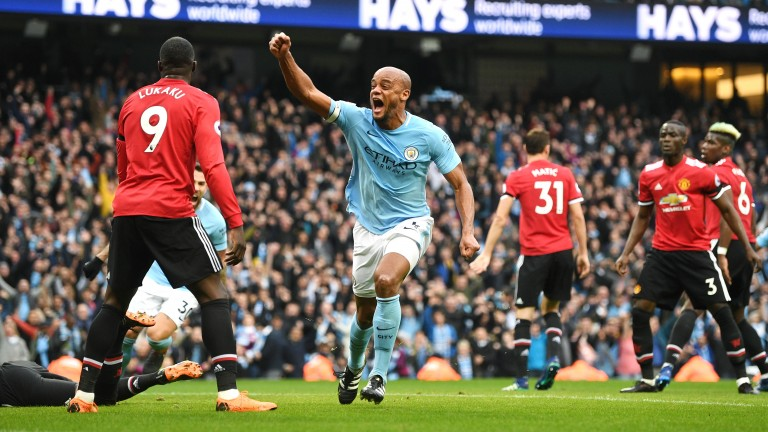 Vincent Kompany celebrates City's first goal against Manchester United at the Etihad Stadium