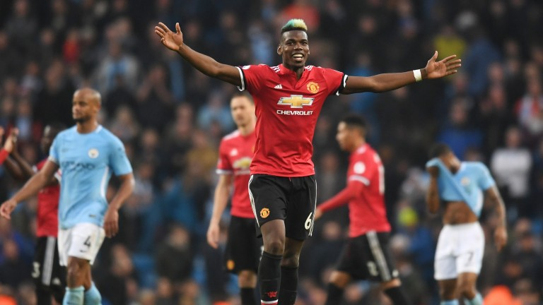 Two-goal Paul Pogba celebrates Manchester United's sensationl win at the Etihad