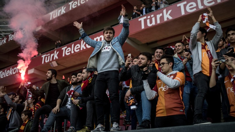 Galatasaray fans cheer on their heroes