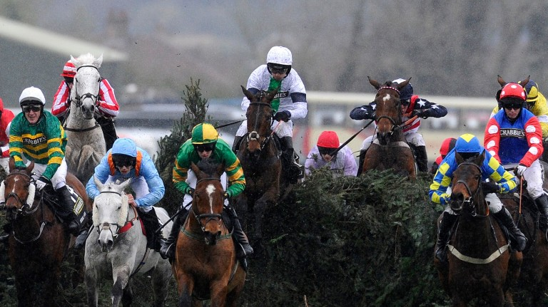 Pineau De Re (Leighton Aspell, white cap, centre) jumps The Chair on the way to Grand National glory