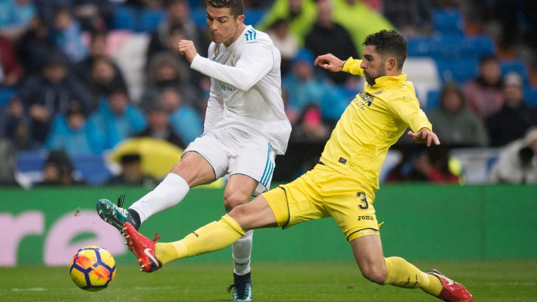 Alvaro Gonzalez of Villarreal challenges Real Madrid's Cristiano Ronaldo