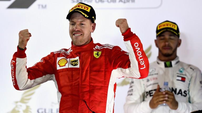 Sebastian Vettel celebrates his Bahrain Grand Prix win as Lewis Hamilton looks on