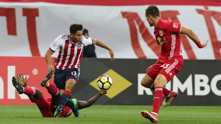 Walter Sandoval of Chivas fights for the ball with Bradley Wright-Phillips