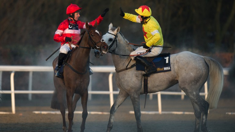 Job well done: Noel Fehily receives a high-five from Al Ferof's rider Daryl Jacob after Silviniaco Conti's victory in the 2013 King George VI Chase