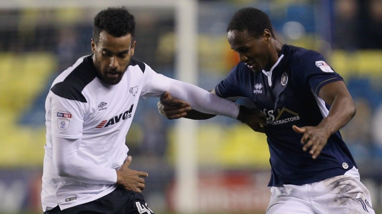 Tom Huddlestone (left) is the protector in midfield for Derby
