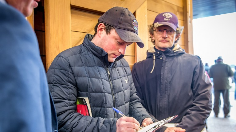 Michael O'Callaghan signs the docket for one of his four purchases
