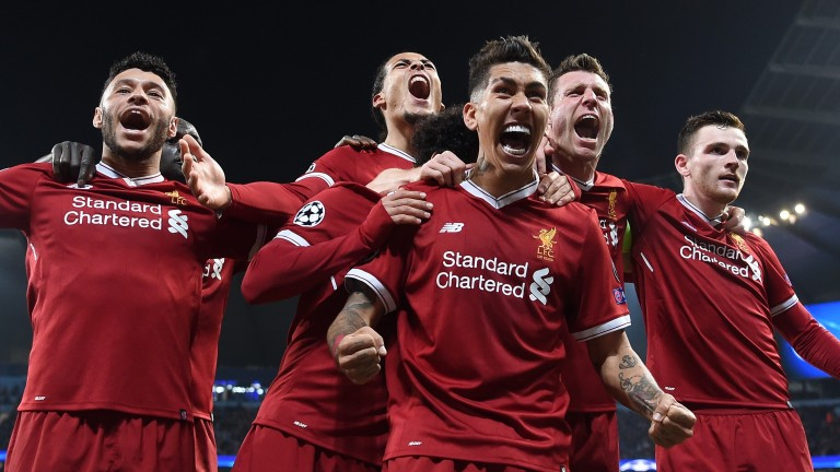Liverpool's Roberto Firmino celebrates scoring the second goal against Man City