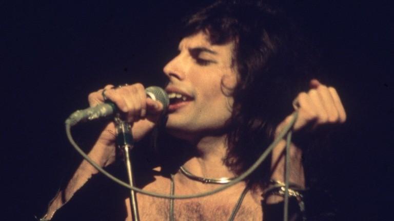 Freddie Mercury, flamboyant frontman of Queen, helps Adam Wedge celebrate a winner