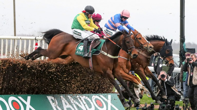 Oscar winner: Finian's Oscar (left) flashes past the beaten pair of Calino D'Airy and Cyrname before catching leader Rene's Girl to record what at one stage looked an unlikely victory in the Manifesto Novices' Chase