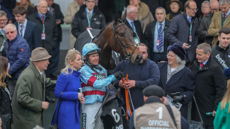 Kayley Woollacott, flanked by Richard Johnson and owner David Staddon, following Grade 1 victory at Aintree in April