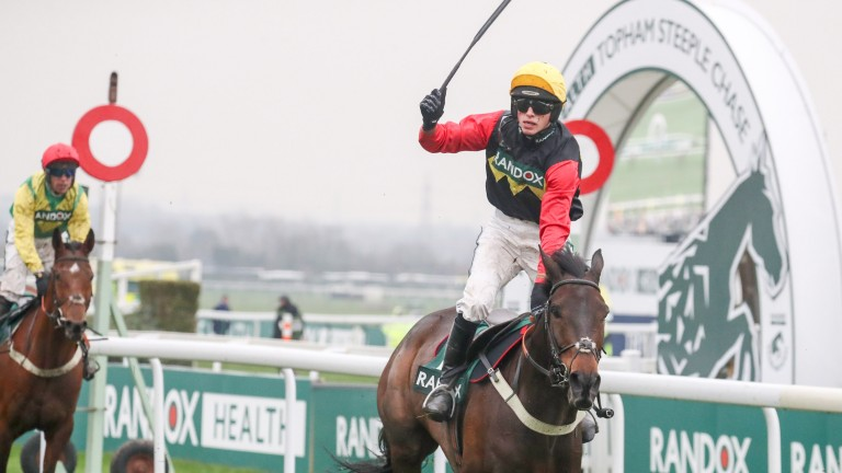 Harry Cobden celebrates after winning the Topham Chase aboard last year's winner Ultragold