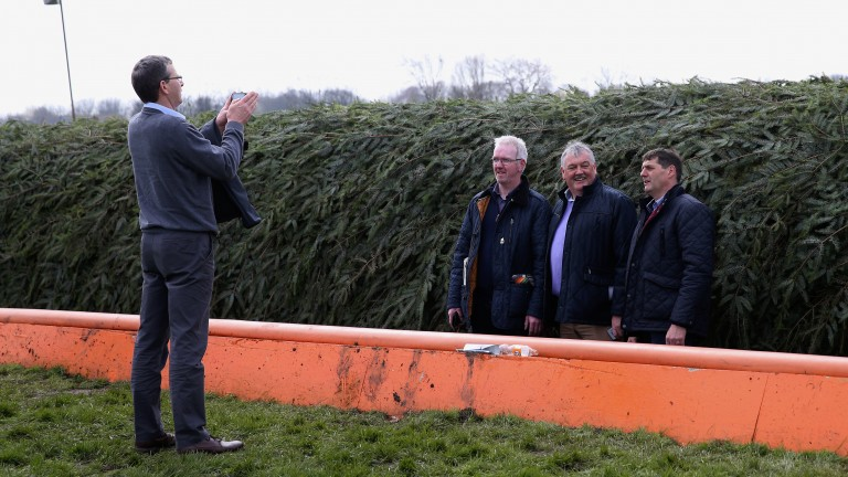 Mind the gap: racegoers take a picture inside the ditch at The Chair