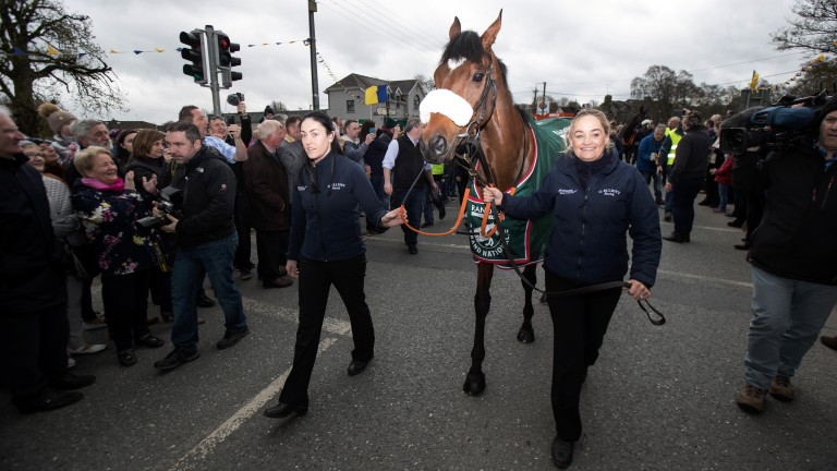 Grand National hero Tiger Roll, led by Karen Morgan (left) and Louise Dunne, is welcomed home by the village of Summerhill