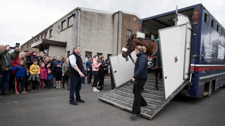 Louise Dunne unloads Grand National winner Tiger Roll at the community centre before parading up the main street of Summerhill