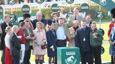Michael O'Leary lifts the Randox Health Grand National trophy along with the Tiger Roll team