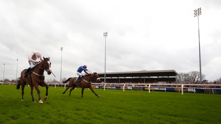 Cue Card (far side) battles on gallantly to beat Vautour in a King George Classic