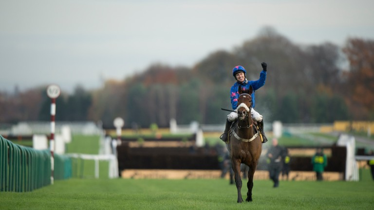 Paddy Brennan celebrates after Cue Card wins his third Betfair Chase