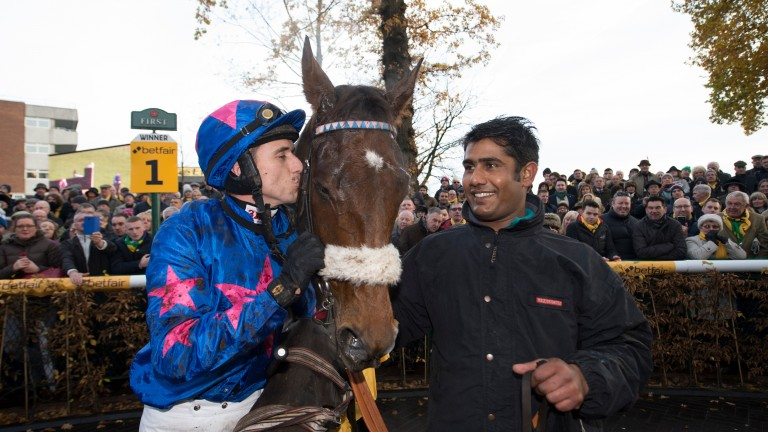 Paddy Brennan plants a kiss on Cue Card as groom Hamir Singh smiles in delight following the horse's victory in the 2016 Betfair Chase