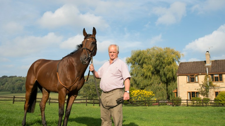 Trainer Colin Tizzard poses with stable star Cue Card