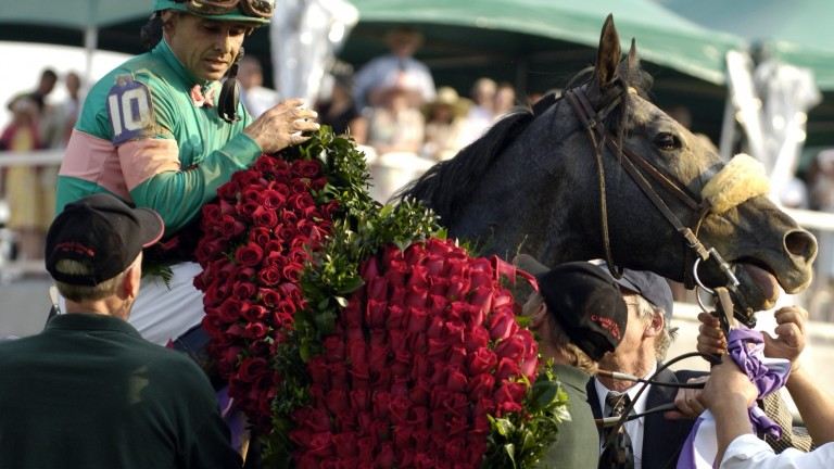 Giacomo and Mike Smith receive the roses after winning the Kentucky Derby