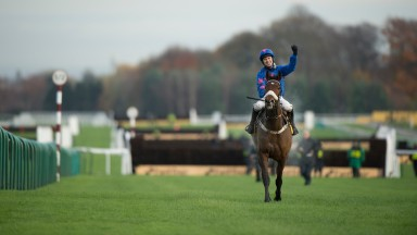 Punching the air: Paddy Brennan celebrates Betfair Chase victory aboard Cue Card in 2016