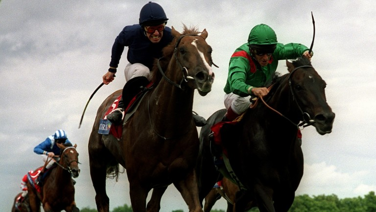 Giant's Causeway (left) with George Duffield repels Kalanisi (Pat Eddery) in a memorable Eclipse