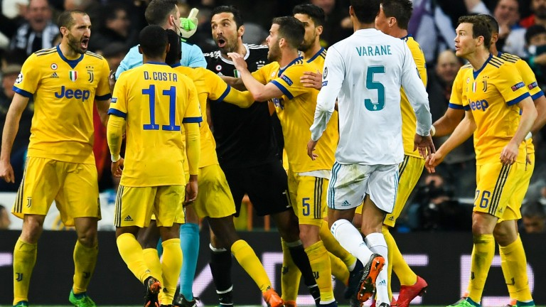 Gianluigi Buffon of Juventus argues with referee Michael Oliver