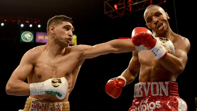 Amir Khan hits Devon Alexander during their welterweight bout at the MGM Grand Garden Arena