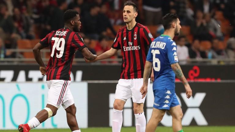 Nikola Kalinic and Franck Kessie celebrate a Milan goal against Sassuolo