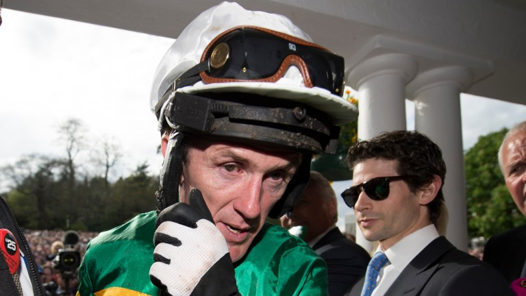 An emotional Tony McCoy walks back to the weighing room for the last time