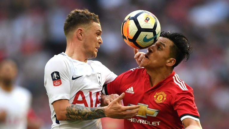 Alexis Sanchez (right) battles with Kieran Trippier of Tottenham in the FA Cup semi-final