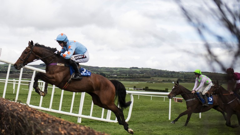 Soaring to victory: Un De Sceaux throws in a typically exuberant jump