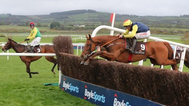The Storyteller and Davy Russell jump the last on the way to victory with the stranded Finian's Oscar in the background