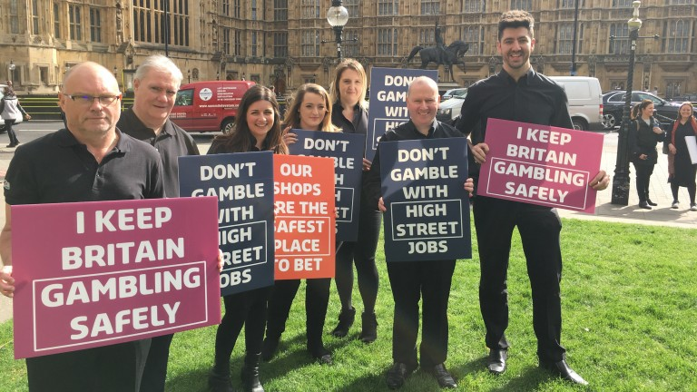 Jenningsbet staff, with Vicky Knight third left, join the demonstration at Westminster