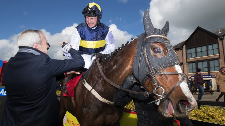 Welcome winner: it was an opening day to forget for Paul Townend but the leading rider was all smiles on day two when greeted by Ruby Walsh after victory aboard the Willie Mullins-trained Pravalaguna in the 2m4f hurdle